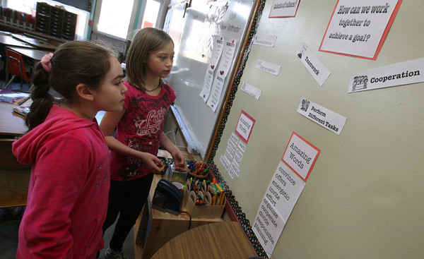 """Gloucester: Lauryn O'Connor, left, and Emily Briere read some of the """"Amazing Words"""" they have learned in 4th grade as part of the new reading curriculum at Beeman Memorial Elementary School. Photo by Kate Glass/Gloucester Daily Times"""