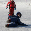 Gloucester: Linden Adamson, front, and his brother, Jeremy, slide across a frozen pond at Bass Rocks Country Club while sledding with their friends on Monday. Photo by Kate Glass/Gloucester Daily Times