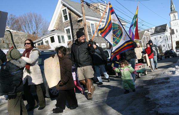 Rockport: John Penaloza smiles at his daughter, Mari Menaloza, 2, as she runs to keep up with the 23rd Annual Martin Luther King Jr. Walk yesterday. The event is organized by the Rockport Unitarian Universalist Church. Photo by Kate Glass/Gloucester Daily Times