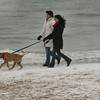 manchester: Lee Nordblom and her daughter Emily Cote take Emily's dog Dakota for a walk just as the snow begins to arrive on Singing Beach Wednesday afternoon. Mary Muckenhoupt/Gloucester Daily Times