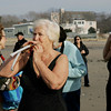 Manchester: Judy Epstein uses noise makers to get the crowd rallied up for the annual charity New Year's Day Swim at Grey Beach in Manchester Saturday afternoon.  This year the swim was to benefit the Greater Boston Food Bank. Mary Muckenhoupt/Gloucester Daily Times