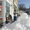 Rockport: Kathleen Cahill shoevels a path to her store Katie's Gift Shop on Main Street Thursday afternoon.  Mary Muckenhoupt/Gloucester Daily Times