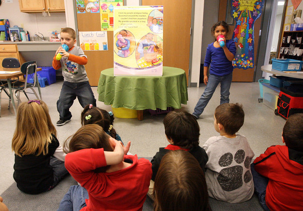 Gloucester: Nikolas Bray and Trinity O'Leary sing the Purple Platypus song in front of Jaclyn Baldassano's kindergarten class as part of a lesson integrating reading with music. Photo by Kate Glass/Gloucester Daily Times