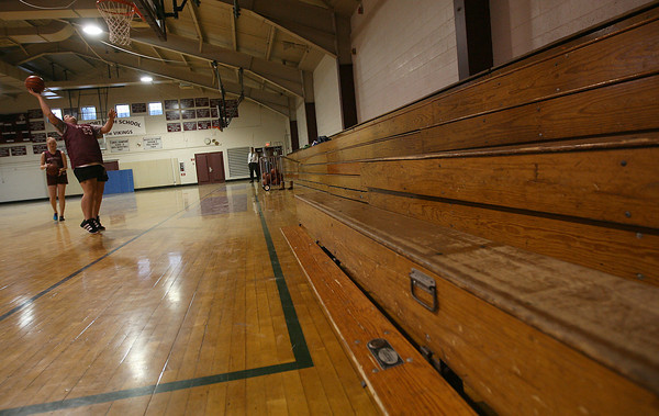Rockport: Kayla Parisi and Sarah Rowen practice their shots in the Rockport High School gym yesterday. The Capital Improvement Committee is recommending $1.1 million for projects such as replacing the high school bleachers, which are warped and cracked, for Fiscal Year 2012. Photo by Kate Glass/Gloucester Daily Times