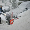 Gloucester: Doug Shatford uses his snow blower to clear the driveway of one of his neighbors on Flume Road in Magnolia during the snow storm Wednesday afternoon. Mary Muckenhoupt/Gloucester Daily Times