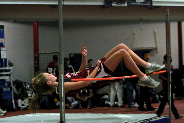 Gloucester: Gloucester's Hannah Sumner clears the bar as she competes in high jump during their meet against Marblehead in at the Benjamin A. Smith Fieldhouse yesterday. Photo by Kate Glass/Gloucester Daily Times