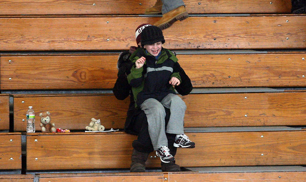 Rockport: Aidan LeBlanc, 6, dances to the music while watching a Rockport High School hockey game with Patty Koning at Talbot Rink. Aidan's brother is on the team. Photo by Kate Glass/Gloucester Daily Times