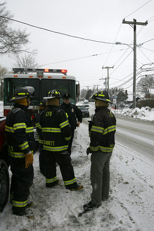 Essex: Essex Firefighters and Police wait to hear when National Grid will be responding to repair utility lines on Main Street that caught on fire, knocking out power to nearly 700 people yesterday afternoon. Photo by Kate Glass/Gloucester Daily Times