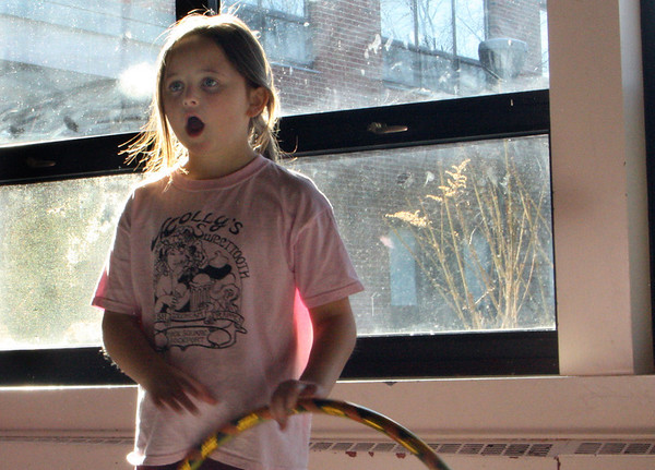 """Molly Timmons, 8, stands in awe of a dance move her instructor just performed at """"Hip Hop Hula Hoops"""" session on Saturday morning at the Rockport Public High School. Jesse Poole/Gloucester Daily Times Jan. 7, 2012"""