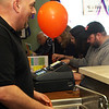 Dean Salah, left, celebrated 10 years of owning George's on Washinton on Saturday by working hard and enjoying conversation with his customers. Jesse Poole/Gloucester Daily Times Jan. 28, 2012