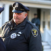 ALLEGRA BOVERMAN/Staff photo. Gloucester Daily Times. Gloucester: People gather at the Greely Funeral Home for a wake for Gloucester Police officer Aran Patrican on Tuesday afternoon. Lt. Kathy Auld, left, speaks with Patrolman Mark Foote.