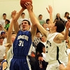 ALLEGRA BOVERMAN/Staff photo. Gloucester Daily Times. Manchester: Georgetown's Patrick Bjork in action against Manchester-Essex in Manchester on Friday evening.