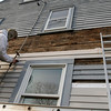 ALLEGRA BOVERMAN/Staff photo. Gloucester Daily Times. Essex: Lifelong Essex resident Kenny Amero is slowly renovating his home, taking off the old siding and putting new up right now. He was working on it on Tuesday afternoon.