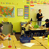 ALLEGRA BOVERMAN/Staff photo. Gloucester Daily Times. Gloucester: Holly Makowski talks with her fourth and fifth graders about how to keep a nutritional and food journal at the Gloucester Community Arts Charter School on Tuesday. The lawsuit against the state and the school was summarily dismissed.