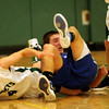 ALLEGRA BOVERMAN/Staff photo. Gloucester Daily Times. Manchester: Manchester-Essex's Chris Bishop, left, and Georgetown's Patrick Bjork land on the floor during their game in Manchester on Friday evening.