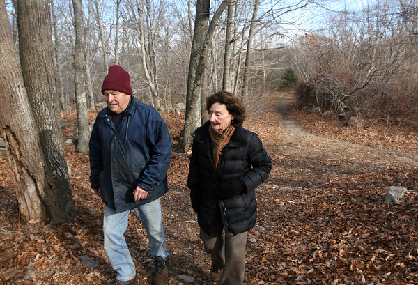 ALLEGRA BOVERMAN/Staff photo. Gloucester Daily Times. Gloucester: Ted Tarr of Rockport, left, and Elaine Clark, also of Rockport, walk along the Olde Rockport Road in Gloucester on Wednesday afternoon, which some residents would like to use as the base for a connector road linking Routes 127 and 128.