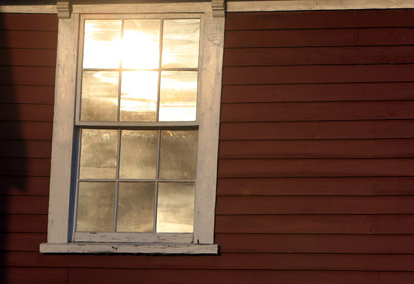 ALLEGRA BOVERMAN/Staff photo. Gloucester Daily Times. Essex: Late afternoon light plays on the Cogswell's Grant buildings on Spring Street in Essex on Friday afternoon.