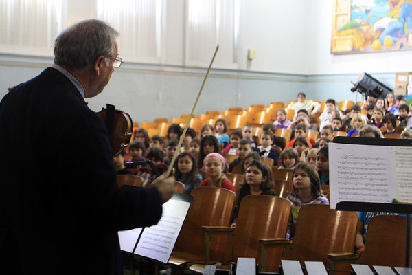 Violinist Alan Hawryluk of Salem visits West Parish Elementary School along with three other musicians and members of the Cape Ann Symphany as part of a orchestra and Internet safety presentation by local Gloucester composer Rob Bradshaw. Jesse Poole/Gloucester Daily Times Jan. 25, 2012