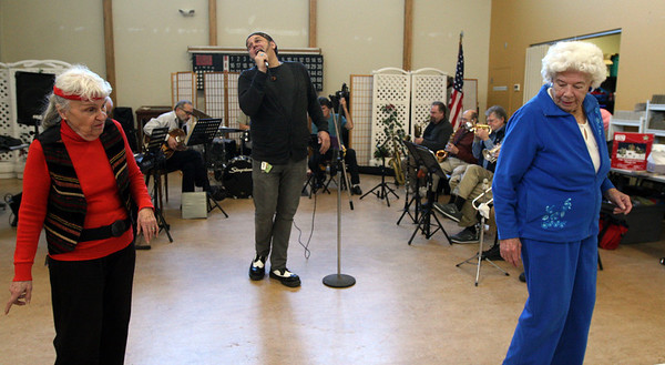 "ALLEGRA BOVERMAN/Staff photo. Gloucester Daily Times. Gloucester: The Good Ole Salty Jazz Band performs every Monday afternoon at 1 p.m. at the Rose Baker Senior Center in Gloucester. As Henry Allen sang, center, Gloria Gallo of Lynn, left, and Evelyn ""Chick"" Nelson of Rockport danced."