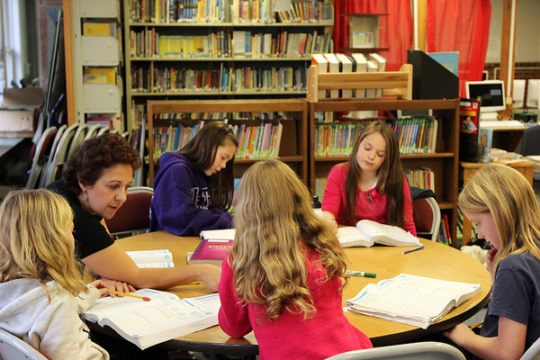 ALLEGRA BOVERMAN/Staff photo. Gloucester Daily Times. Gloucester: Regina Sargent's third grade class has relocated temporarily to the library while her classroom's heat and various burst pipes are repaired. They were learning about perimeters, angles and area on Thursday afternoon.