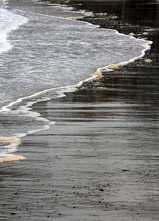 ALLEGRA BOVERMAN/Staff photo. Gloucester Daily Times. Rockport: Detail of the tide along Rockport's Beach Street.