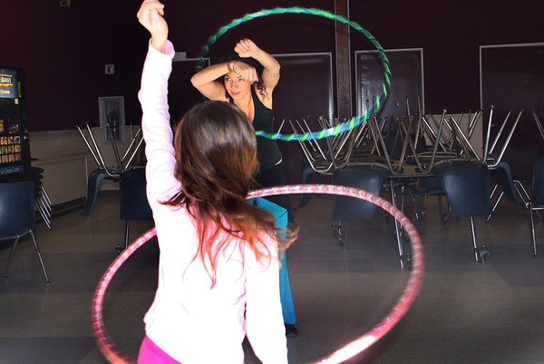 Rebecca De Loach of Rockport's recreation department instructs a group of girls in the art of hip hop dancing using hula hoops in the cafeteria of the Rockport Public High School on Saturday morning. Jesse Poole/Gloucester Daily Times Jan. 7, 2012