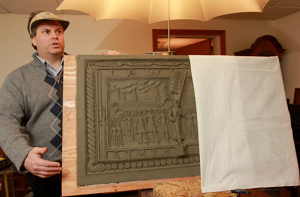 ALLEGRA BOVERMAN/Staff photo. Eagle-Tribune. Gloucester: Sculptor Daniel Altshuler of Gloucester is working on two bronze plaques that will commemorate the Bread and Roses Strike of 1912 and be placed in Lawrence's Campagnone Common a few hundred feet west of City Hall.