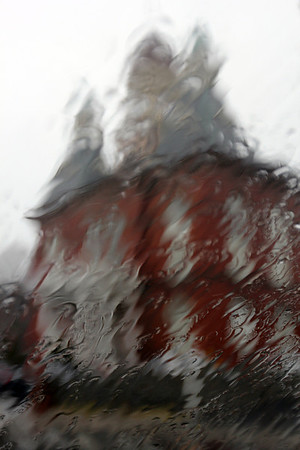 ALLEGRA BOVERMAN/Staff photo. Gloucester Daily Times. Gloucester: A view of Gloucester's City Hall in the heavy rain on Thursday as seen through a car windshield.