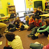 ALLEGRA BOVERMAN/Staff photo. Gloucester Daily Times. Gloucester: Damon Nillson, left, reads with his second and third graders at the Gloucester Community Arts Charter School on Tuesday. The lawsuit against the state and the school was summarily dismissed.