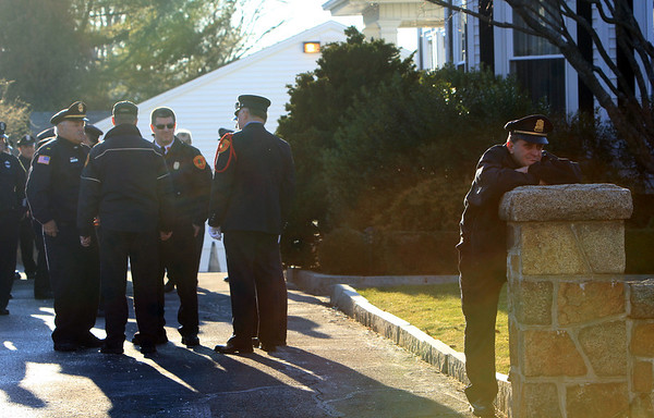 ALLEGRA BOVERMAN/Staff photo. Gloucester Daily Times. Gloucester: Gloucester Lt. Joey Foote, far right, reflects while at the Greely Funeral Home for a wake for Gloucester Police officer Aran Patrican on Tuesday afternoon.