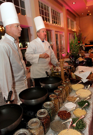 ALLEGRA BOVERMAN/Staff photo. Gloucester Daily Times. Gloucester: Over 1000 people attended the fourth annual Cruiseport Gloucester Bridal Show and Wedding Expo on Thursday evening. Thousands of different kinds of hors d'oeuvres and specialty pasta dishes were served by Vinwood Catering, as well as desserts, smoothies and other beverages. Vinwood's Bill Blaisdell, left, and Vinwood owner Tom Lang were on hand all night.