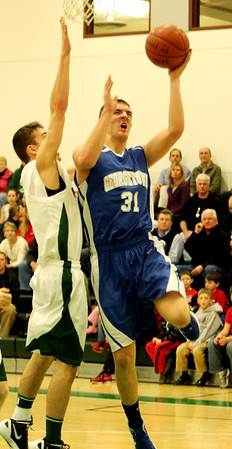 ALLEGRA BOVERMAN/Staff photo. Gloucester Daily Times. Manchester: Georgetown's Patrick Bjork, right, in action against Manchester-Essex's Chris Bishop during their game in Manchester on Friday night.