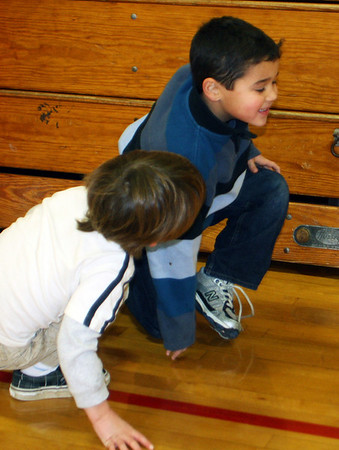 ESSEX-Kindergartener Beckett Walker, left, tackles his classmate and birthday-boy Logan DeSouza last Tuesday the 17th at Essex Elementary School in a game of tag during gym class. Jesse Poole/Gloucester Daily Times Jan. 17, 2011