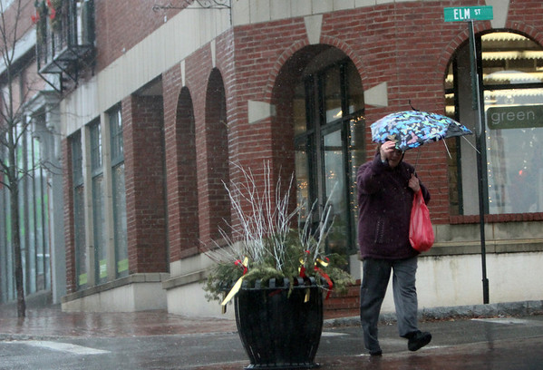 ALLEGRA BOVERMAN/Staff photo. Gloucester Daily Times. Gloucester: Umbrellas were not enough to protect people from the wind and driving rain in Gloucester on Thursday.