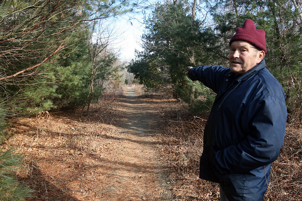 ALLEGRA BOVERMAN/Staff photo. Gloucester Daily Times. Gloucester: Ted Tarr of Rockport, walks along the Olde Rockport Road in Gloucester on Wednesday afternoon, which some residents would like to use as the base for a connector road linking Routes 127 and 128.
