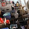 ALLEGRA BOVERMAN/Staff photo. Gloucester Daily Times. Gloucester: ALLEGRA BOVERMAN/Staff photo. Gloucester Daily Times. Gloucester: Gloucester fire personnel and U.S. Coast Guard personnel get ready to transport Leo Vitale, a worker who fell off a dock onto a boat below at the BASE Gloucester Seafood Exchange on Monday afternoon. He was transported to Beverly Hospital.