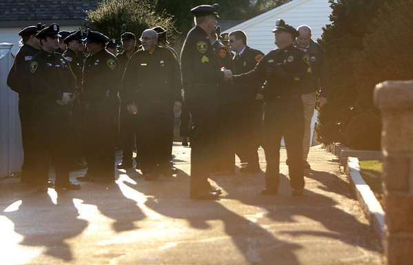 ALLEGRA BOVERMAN/Staff photo. Gloucester Daily Times. Gloucester: People gather at the Greely Funeral Home for a wake for Gloucester Police officer Aran Patrican on Tuesday afternoon.
