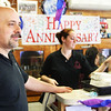 Dean Salah celebrated 10 years of owning George's Coffee Shop on Washington in Gloucester on Saturday by working hard and talking to his customers and friends. Jesse Poole/Gloucester Daily Times Jan. 28, 2012