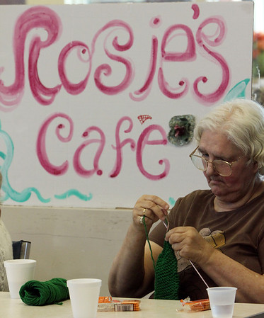 ALLEGRA BOVERMAN/Staff photo. Gloucester Daily Times. Gloucester: Connie Giamanco of Gloucester knits a bright green sweater at the Rose Baker Senior Center on Monday afternoon. She knits for servicemen and women.