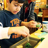 Jake Giarratana of Danvers visits the Manchester Public Library on Saturday morning to take part in a fun hands-on science workshop. Here he's dying an ice cube green. Jesse Poole/Gloucester Daily Times Jan. 7, 2012