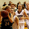 ALLEGRA BOVERMAN/Staff photo. Gloucester Daily Times. Rockport: Manchester Essex's Ally Conway in action, far left, against Rockport's Gabby Muniz, right behind her, at Rockport on Tuesday evening.