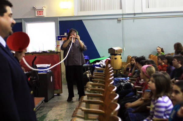 Gloucester composer Rob Bradshaw, left, helps Janet Harrison of the Cape Ann Symphony demonstrate how long her French Horn would be if it were stretched out. This is part of an orchestra and Internet safety presentation conducted by Rob Bradshaw at West Parish Elementary School sponsored by Music Drives Us. Jesse Poole/Gloucester Daily Times Jan. 25, 2012