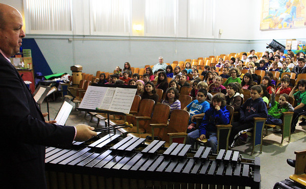 Kris Asgeirsson of Reading plays the marimba for a focused group of fourth and fifth graders at West Parish Elementary School as part of an orchestra and Internet safety presentation conducted by Rob Bradshaw at West Parish Elementary School sponsored by Music Drives Us. Jesse Poole/Gloucester Daily Times Jan. 25, 2012