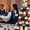 ALLEGRA BOVERMAN/Staff photo. Gloucester Daily Times. Gloucester: Over 1000 people attended the fourth annual Cruiseport Gloucester Bridal Show and Wedding Expo on Thursday evening. From left, John Turner, Jo-Ann Bucci, and Ana Machado, all of Rockin' Cupcakes of Rockport, and all of Lawrence, hand out samples of their cupcakes during the event.