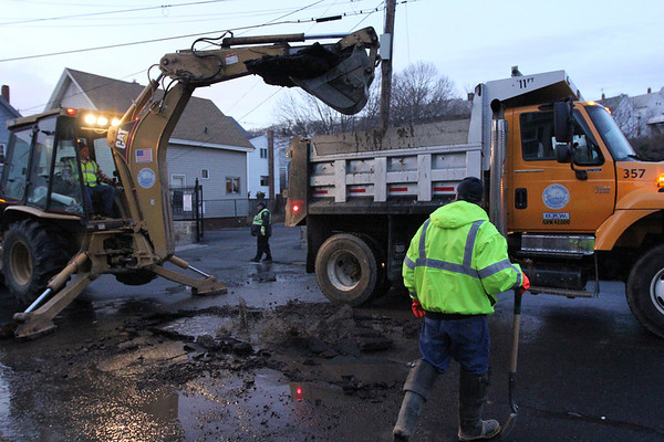 ALLEGRA BOVERMAN/Staff photo. Gloucester Daily Times. Gloucester: Gloucester Department of Public Works employees work to uncover the water main pipe that broke on Prospect Street on Friday afternoon.