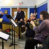From left, Rob Bradshaw, Kris Asgeirsson, Alan Hawryluk, Janet Harrison and Antanas Meilus perform Bradshaw's music for a group of fourth and fifth graders at West Parish Elementary School as part of an orchestra and Internet safety presentation conducted by Bradshaw at West Parish Elementary School sponsored by Music Drives Us. Jesse Poole/Gloucester Daily Times Jan. 25, 2012