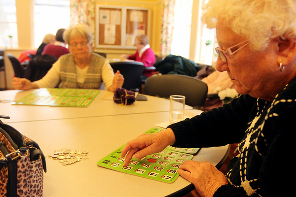 ALLEGRA BOVERMAN/Staff photo. Gloucester Daily Times. Rockport: Bingo is held every Monday at from 1 p.m. - 3:30 p.m. at the Rockport Council On Aging Senior Center at Community House. Front, right is Janice Johnson, and left back is Betty Scatterday. About a dozen people were playing on Monday afternoon.