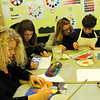 ALLEGRA BOVERMAN/Staff photo. Gloucester Daily Times. Gloucester: Shay Cajolet, the director of arts integration, center, works with Ryan Parisi, a sixth grader, right, in the visual arts class at the Gloucester Community Arts Charter School on Tuesday. The lawsuit against the state and the school was summarily dismissed. At left, from left, are seventh graders Laney Lavelle, and Shannon Kelly.