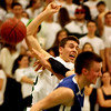 ALLEGRA BOVERMAN/Staff photo. Gloucester Daily Times. Manchester: Manchester-Essex's Chris Bishop, left, in action against Georgetown's Tyler Wade, right, during their game in Manchester on Friday evening.