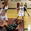ALLEGRA BOVERMAN/Staff photo. Gloucester Daily Times. Rockport: Manchester Essex's Rachel Daley, bottom, in action against Rockport's Heather MacArthur, left, during their game in Rockport on Tuesday evening.